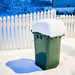 Garbage bin covered with a thick layer of snow