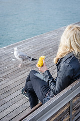 Hungry (Luis Alvarez Marra) Tags: seagull port ocean corn blond outdoor decisive moment color collecting soul candid street streettog tog nikon d7000 prime 24mm spain catalonia barcelona
