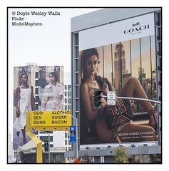 Billboards, Sunset Boulevard (Doyle Wesley Walls) Tags: lagniappe 9386 sign signs billboards billboard selenagomez words text buildings street celebrity coach bag sunsetboulevard losangeles doylewesleywalls