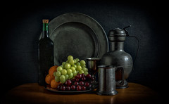 Fruit and wine (Johnny_7) Tags: pewter still life grapes tangerines fruit jug plates cups tankard wine bottle
