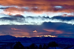 Layers of Color at Sunset (Ginger H Robinson) Tags: layers clouds mountains silhouette sunset light reflection rockymountain frontrange foothills denverbasin denver colorado winter dusk january snow pine tree sky shadow mountain landscape