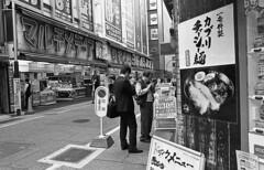 Shinjuku (Manuel Goncalves) Tags: tokyo shinjuku street urban city people nikonn90s nikkor28mm orientalseagull400 35mmfilm blackandwhite epsonv500scanner
