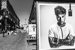*UrbanMilano* (marco.fanchini) Tags: sky city people contrast europe italy urban architecture cityscape road building bokeh closeup shadow black white advertising looking walking spot poster architectural perspective image singer milano series dante fedez marcofanchini 500px