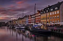 Nyhaven at dusk (ArmyJacket) Tags: denmark europe travel explore scenic zealand scandavia trip copenhagen city urban buildings capitol boat sunset clouds water historic building sky harbour tourist nyhavn architecture