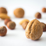 Mix a Nuts with Walnut Close Up in Front thumbnail