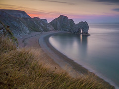 Reasons To Love Summer Mornings (Wizard CG) Tags: durdle door hdr dorset olympus epl1 jurassic coast natural limestone arch landscape cliffs shingle beaches world trekker ngc sand fine pebbles sea heritage waves water outdoor sunset mountain ocean bay sky grass rock