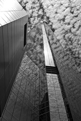La tour dans les nuages 2 B&W (maggy le saux) Tags: torrebuildingskycraper gratteciel costaneracenter santiago chile nubes nuages cloud bleuetblanc contreplongée lowangle lignesdefuite vanishingpoint reflection
