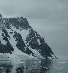 The coast of the Antarctic Peninsula (Ruby 2417) Tags: antarctica antarctic peninsula mountain rock crag stone snow ice glacier glaciation ocean sea coast water