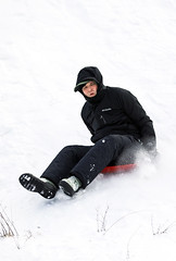 Nate On A Downhill Slide (wyojones) Tags: wyoming cody absarokamountains shoshonenationalforest sledding sliding hillside clearwatercreekcampground show sled nathan hood coat expression wyojones