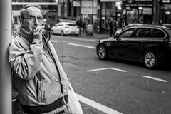 Electronic (Leanne Boulton) Tags: urban street candid portrait portraiture streetphotography candidstreetphotography candidportrait streetportrait eyecontact candideyecontact streetlife old elderly man male face expression eyes mood feeling smoke smoker smoking ecig electronic cigarette vape vaper vaping tone texture detail depthoffield bokeh naturallight outdoor light shade city scene human life living humanity society culture lifestyle people canon canon5dmkiii 50mm black white blackwhite bw mono blackandwhite monochrome glasgow scotland uk