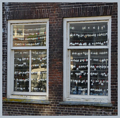 In the season-fitting windows (joeke pieters) Tags: 1444094 panasonicdmcfz150 dordrecht zuidholland nederland netherlands holland raam window hww kerstballen christmasdecorations reflections