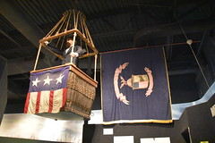 John B Mahaffey Museum Complex (Adventurer Dustin Holmes) Tags: 2018 engineers corpsofengineers army us unitedstates indoor military museum johnbmahaffeymuseum mahaffeymuseum exhibit exhibits display displays basket flag balloon mannequin political banner blackceiling ceiling cloth old antique male man tophat wicker facialhair beard bearded