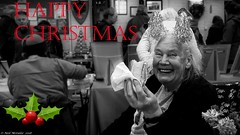 Village Christmas 2018 (Neil. Moralee) Tags: neilmoralee christmas old mature woman eating sandwich fun tinsle decoration happy hemyock devon village market holiday black white bw bandw red text blackandwhite neil moralee panasonic lumix lx7 2018 sleigh bells lights people