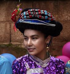 Mosuo Woman (Rod Waddington) Tags: china chinese yunnan mosuo minority ethnic ethnicity traditional regalia hat tibetan buddhist candid portrait people outdoor happyplanet