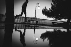 Mid Air (FButzi) Tags: genova genoa liguria italy italia spianata castelletto runner bw reflection street