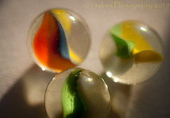 Remember When I Was Young (HMM) (13skies) Tags: hmm happymacromondays macroscopic glass marbles twisted inside light round colours color play theme macromondays macromonday sonyalpha100 sony made roll shoot close macro