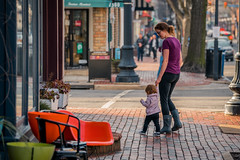 Momma Help Me! (John Brighenti) Tags: outdoors outside urban street photography alexandria virginia va oldtown brick sidwalk evening goldnenhour city downtown buildings walls roads businesses signs people humans walking mother child children toddler baby sony alpha a7rii ilce7rn2 sel70200g nex emount femount ilce zoom gmaster