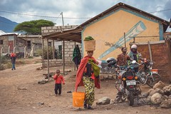 Haki Ya Kuandika (u c c r o w) Tags: woman child arusha tanzania africa colorful colors motorcycle motorbike urban urbanlife city citylife tanzanian street streetlife streetphotography uccrow red outdoor outside maasai graffiti