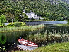 Kylemore Abbey (pandt) Tags: connemara kylemore abbey ireland vacation outdoor landscape waterscape water lake boat historic marsh trees green white red irish