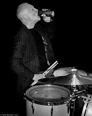 Heavy Fuel. (Neil. Moralee) Tags: anything but thatneilmoralee man old mature drum drummer beer drink drinking drinker music alcohol direstraits heavyfuel black white bw bandw blackandwhite song musician player rock roll metal heavy fuel beard jacket blackbackground neil moralee nikon d7200 monochrome mono