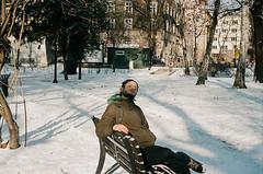barefoot in the park (Lentejas Puag) Tags: 35mm film filmisnotdead fujifilm portrait park snow winter poland krakow cracow polska guy analog analoguevibes vibes tree trees shadows nikon nikonf70
