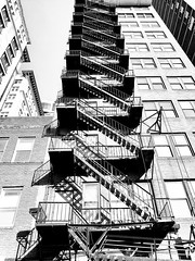 Fire Escape Philadelphia (MassiveKontent) Tags: streetphotography bwphotography streetshot architecture building bw contrast city monochrome urban blackandwhite streetphoto shadows perspective philadelphia metropolis metropolitan america cityscape usa unitedstates downtown buildings architect structure philly pa pennsylvania explore 215 fireescape urbandecay