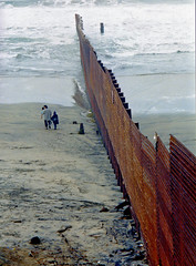 Before The Real Wall (SheffieldStar) Tags: scannedimage mexico hispanic divide 2000 rust fence coronado surf pacificocean border family outdoors corrugated immigration illegalimmigration humour