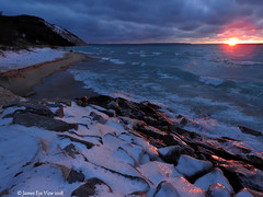Pink Ice (JamesEyeViewPhotography) Tags: lake michigan water waves winter ice clouds sky cold colors beach sunset sand dunes greatlakes december landscape lakemichigan northernmichigan nature snow rocks jameseyeviewphotography