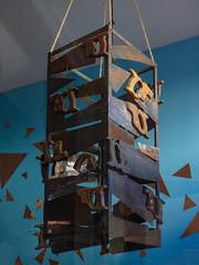 The Box Saws (Steve Taylor (Photography)) Tags: saw box art sculpture brown blue string metal rust newzealand nz southisland canterbury christchurch cbd city triangle bent