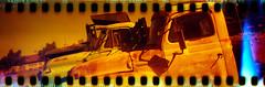 Redscale Trucks (No Stone Unturned Photography) Tags: redscale kodak folding expired 800 35mm film sprocketholes jiffy camera art deco 1933 six16 616 panoramic