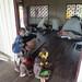 Uwus children watch sleeping travellers