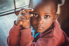 More Than Words (u c c r o w) Tags: maasai student child baby eyes class portrait tanzania arusha africa african colors hands look beautiful beauty people