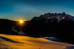 Sunrise in the Italian Alps (K.H.Reichert [ not explored ]) Tags: sonnenstern schnee sunstar sky sunrise südtirol southtyrol alpen winter mountains berge berg dolomiten reise natur snow