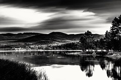 Long exposure of about 30 minutes.  Taken on the banks of loch morlich. Looking south into the Cairngorms The long exposure i think helps bring out the contrast of light and shadow as the clouds moved over the landscape.  . https://www.richardhague.com . (Richard Hague Photography) Tags: britain cairngormsnationalpark lochmorlich autumn autumncolours clouds colours dusk fall fallcolors forrest goldenhour greatoutdoors green landscape landscapephotography leadingline leadinglines light loch longexposure movement nature nopeople outdoors photography red scotland shadow silhouette sky sunset trail tree treeline trees twilight uk water woodland woods yellow aviemore unitedkingdom gb