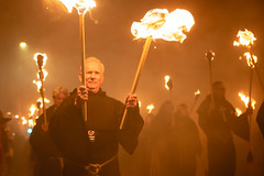 Members of Southover Bonfire society (lomokev) Tags: file:name=1811055dmrk32431 sussex lewes 5thnovember fifthnovember bonfirenight guyfawkesnight fire torches torch jumper firelight parade lewesbonfire canoneos5d canon eos 5d monk