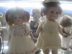 more toys (VERUSHKA4) Tags: canon europe russia moscow ville city october autumn astoundingimage vue view shop shopwindow doll toy eyes face mouth dress clothes shelf childhood beautiful oldtoy girl two