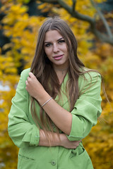 Kornelia and the leaves (piotr_szymanek) Tags: kornelia korneliaw woman young skinny portrait outdoor face longhair park autumn yellow green hand eyesoncamera leaves 1k 5k 20f 50f 10k 100f 20k