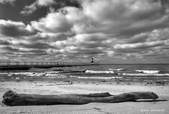 After the Storm (mswan777) Tags: beach sand pier lighthouse outdoor nature driftwood wave water sky cloud seascape horizon monochrome black white ansel st joseph michigan apple iphoneography iphone mobile