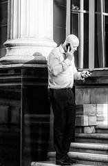 The Deal Maker (<Derek>) Tags: projectsunday streetphotography man dealmaker monochrome mono blackandwhite bw canong7x