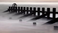 I'm all lost (PeskyMesky) Tags: aberdeen aberdeenbeach longexposure groyne scotland water sea ocean mist december 2008 flickr canon canon5d eos