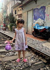 Girl on Train Street (cowyeow) Tags: hanoi vietnam asia asian street urban city people candid girl littlegirl young train tracks trainstreet weird dangerous travel pretty portrait composition