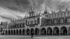 The Medieval Gothic Cloth Hall (Sukiennice) (Rynek Glowny - Market Square) (Krakow Old Town - Stare Miasto) (Monochrome) (Fujifilm X100F Compact) (1 of 1) (markdbaynham) Tags: krakow cracow poland polish polen polska city cityscape citybreak polishcity travel highendcompact historiccity historicplace medievalcity famousplace staremiasto oldtown medievaltown historictown fujifilm fuji fujix fujinon fujista x100f x100 fujix100f fujifilmx100f apsc transx transxsensor fixedlens primelens prime 23mm f2 rynekglowny