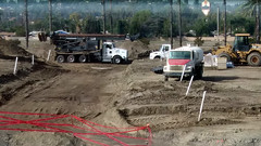 (Rich T. Par) Tags: pomona phillipsranch socal southerncalifornia losangelescounty lacounty constructionsite california palmtrees tree road suburb dirt civilengineering tubes tractor heavyequipment pipes watertruck frontloader drill drillingmachine drillingtruck