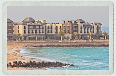 Postcard (Daniela 59) Tags: swakopmund strandhotel mole ocean rocks building holidayresort sliderssunday 52in2018challenge namibia 13holiday danielaruppel hss