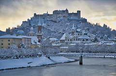 Salzburg in snow (echumachenco) Tags: salzburg austria österreich city architecture history medieval baroque fortress festung castle hohensalzburg evangelischechristuskirche kollegienkirche franziskanerkirche cathedral dom winter snow roof building house january bridge müllnersteg river water salzach riverside elisabethkai sky cloud light nikond3100 tree forest wood