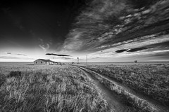And The Road Leads Home (Tom Herlyck) Tags: america blackwhite colorado digital easterncolorado flickr highplains jazzed light moved natural outdoors pueblocounty road sky usa windmill a7rii bw exposure fall greatamericandesert house vanishingpoint landscape neglected prairie shortgrassprairie sunset