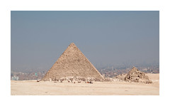 Giza's Famous Scene and A Travel Story (The Spirit of the World ( On and Off)) Tags: pyramid cairo cityskyline camels horsebuggies unescoworldheritagesite wonderoftheworld historical egypt middleeast africa landscape sand desert sandstorm dusty
