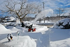 Sending it across the farm.... (ineedathis, Everyday I get up, it's a great day!) Tags: blizzardnemo snowstorm snow clouds bluesky snowblower me mywifetookthephoto trees winter nikond80 longisland driveway lamppost narcissus path light farm street fence bushes evergreen pines