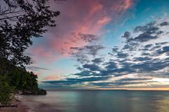 Lake Michigan Sunset Palette (matthewkaz) Tags: christmascove christmascovebeach sunset sky clouds lakemichigan lake water greatlakes reflection reflections puremichigan leelanau leelanaupeninsula summer beach trees longexposure northport michigan 2017