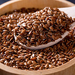 Flax seeds in a wooden bowl thumbnail